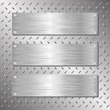 Plaques. Three steel plaques on iron background Royalty Free Stock Photo