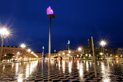 Plase Massena Nice France. A rainy night in Nice, France. Place Massena, Conversation in Nice statues by Jaume Plensa royalty free stock photography
