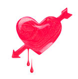 Plash of nail polish in the form of heart with arrow Royalty Free Stock Photography