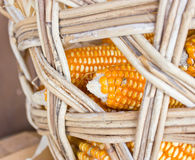 Plasic Corns In Bamboo Container. Royalty Free Stock Images