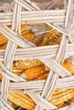 Plasic Corns In Bamboo Container. Stock Photos