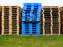Plasic and wooden pallets Royalty Free Stock Photo