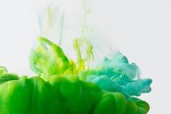 Plaskar den övre sikten för slutet av blandning av målarfärger Arkivbilder