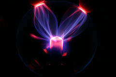 Plasma ball. A glowing plasma ball with fingers on it Royalty Free Stock Images