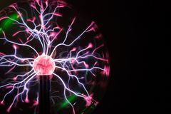 Plasma ball in action. Space for text Stock Images