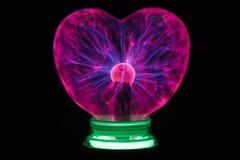 Plasma ball heart glowing in the dark Royalty Free Stock Photo