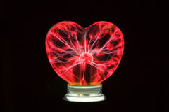 Plasma ball heart glowing in the dark Royalty Free Stock Photography