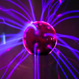 Plasma ball  with magenta-blue flames Royalty Free Stock Photography