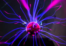 Plasma ball  with magenta-blue flames Stock Images