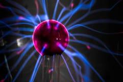 Plasma ball  with magenta-blue flames Stock Photo