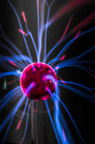 Plasma ball  with magenta-blue flames Royalty Free Stock Image