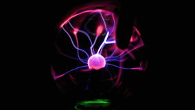 Plasma Ball with Moving Energy Rays Inside on Black Background. Close-up View. Close-up view of plasma ball with moving energy rays inside on black background stock video