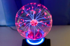 Plasma ball. With smooth magenta-blue flames Royalty Free Stock Images