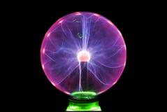 Plasma ball. Violet plasma ball lamp on black background royalty free stock photos