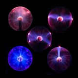 Plasma balls. A few isolated plasma ball party lamps Royalty Free Stock Photography