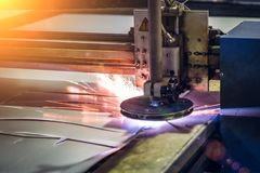 Plasma cut machine cutting steel sheet with sparks. Lasercutting  of industrial iron works Royalty Free Stock Photography