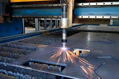 Plasma cutting machine, flame with sparks, metal cut process, metal cutting. Plasma cutting machine, flame with sparks, thick metal cutting, metal cut  process royalty free stock photo