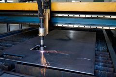 Plasma cutting machine, flame with sparks, metal cut process, metal cutting stock images