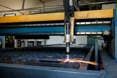 Plasma cutting machine, flame with sparks, metal cut process, metal cutting royalty free stock images