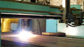 Plasma cutting of metal on an automatic laser machine, laser plasma cutting machine for cutting parts from metal stock footage