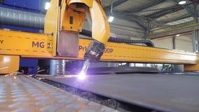 Plasma cutting of metal sheet stock video footage