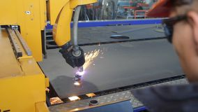Plasma cutting of metal sheet. The metal cutting machine plasma stock footage