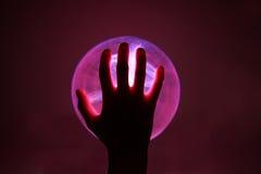 plasma de main de bille Photographie stock