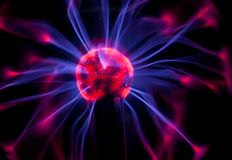 Plasma globe with red and blue arcs on a black background Stock Images