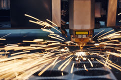 Plasma or laser cutting metalworking with sparks stock images