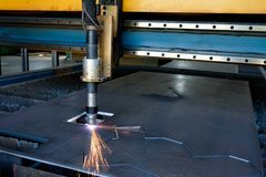 Plasma cutting machine, flame with sparks, metal cut process, metal cutting royalty free stock photography
