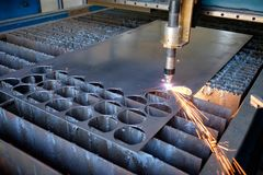 Plasma cutting machine, flame with sparks, metal cut process, metal cutting stock photo