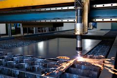 Plasma machine cutting a sheet of metal, metal cut process, metal cutting royalty free stock image