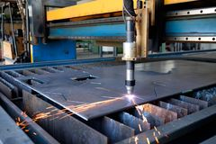 Plasma machine cutting a sheet of metal, metal cut process, metal cutting stock photo