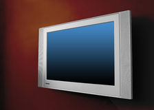 Plasma moderno TV sulla parete marrone Fotografie Stock