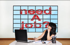 Plasma with need a job. Businesswoman in office looking at plasma with need a job Royalty Free Stock Images
