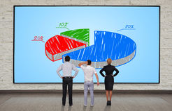 Plasma panel with chart. Businesspeople looking at plasma panel with chart Royalty Free Stock Photography
