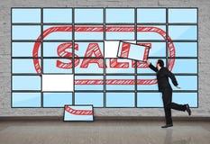 Plasma panel with sale. Businessman puts plasma panel with sale Stock Photo
