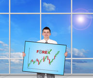 Plasma panel with success chart. Businessman holding plasma panel with success chart Stock Image