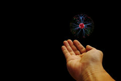 Plasma power. A digitally prepared image of a hand and a plasma energy ball stock image