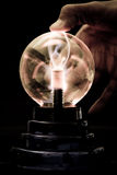 Plasma Tesla Orb. With Hand In Dark Setting Royalty Free Stock Photography