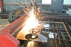 Plasma Torch. CNC Plasma torch table cutting half inch mild steal royalty free stock image