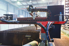 Plasma torches of cutting machine close up. In mechanical shop Stock Photo