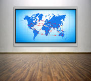 Plasma tv with air travel scheme. On the wall in office Royalty Free Stock Photos