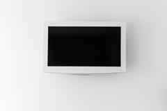 Plasma TV en la pared del cuarto Imagenes de archivo