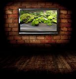 Plasma TV on the wall. With possitive picture Royalty Free Stock Photography