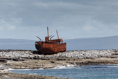 Plassey rusted shipwreck hulk on rocks at low tide Royalty Free Stock Images