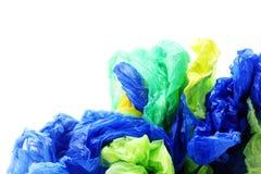 Plast- avskrädepåsar på vit bakgrund Royaltyfria Bilder