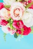 Plast- blomma på blått Royaltyfria Bilder