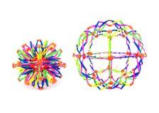 Plast- bollleksak för elasticitet som två isoleras på vit bakgrund Den f?rgrika elasticitetsbollleksaken isolerade fotografering för bildbyråer