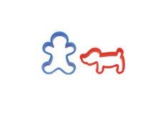 Plast- diagram av en man och en hund toy Arkivfoton